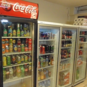 Night shop. Cans of beer and soft drinks.